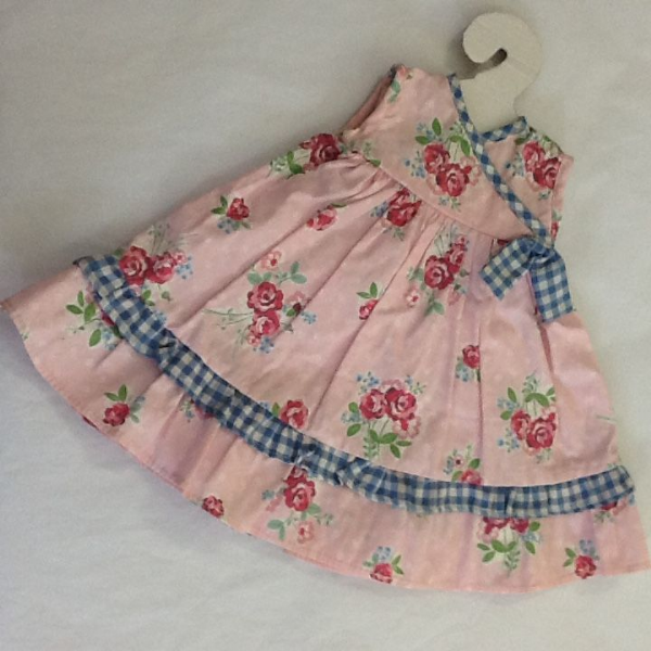 Pretty pink floral and spot dress and bloomers with cross over detail, to fit approx 16 inch doll.